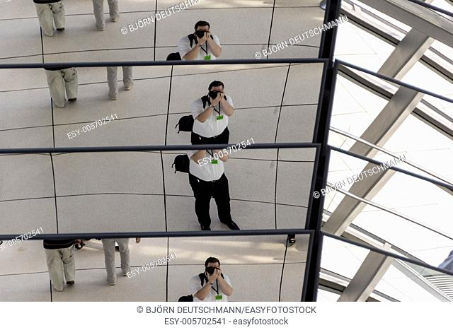 A self-portrait taken in the glass dome of the Reichstag building in Berlin