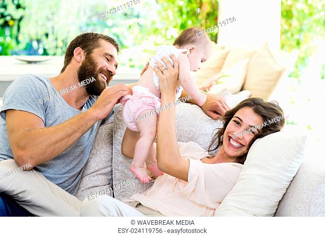 Happy parents playing with their baby