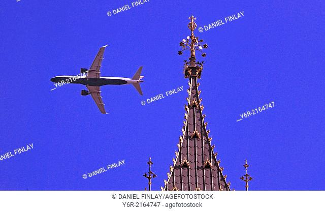 Plane flying past Big Ben in Westminster in the heart of London, England