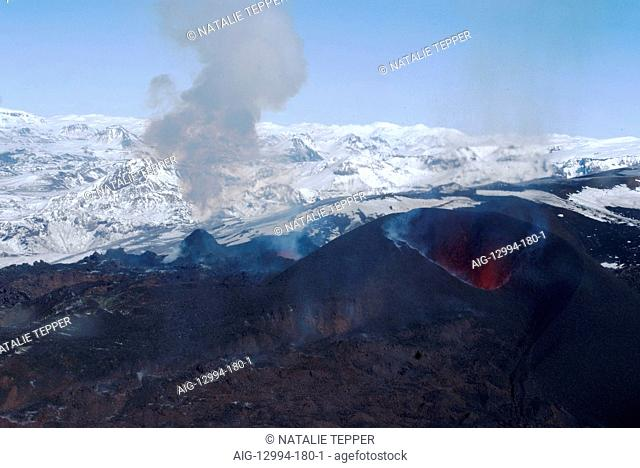 Erupting Eyjafjallajokull volcano and newly-built cinder cone, Southern Iceland