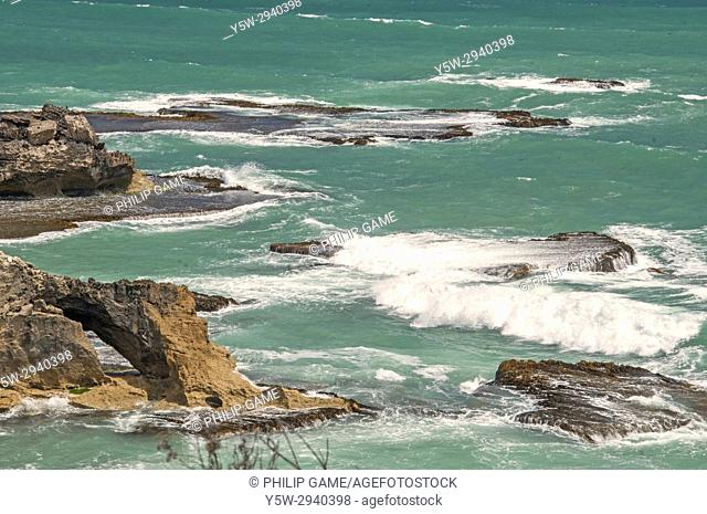 Waves breaking on limestone rock shelves at Cape Northumberland, Port MacDonnell, South Australia