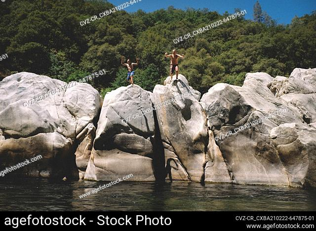 Two Boys Jump from Boulders at the Yuba River