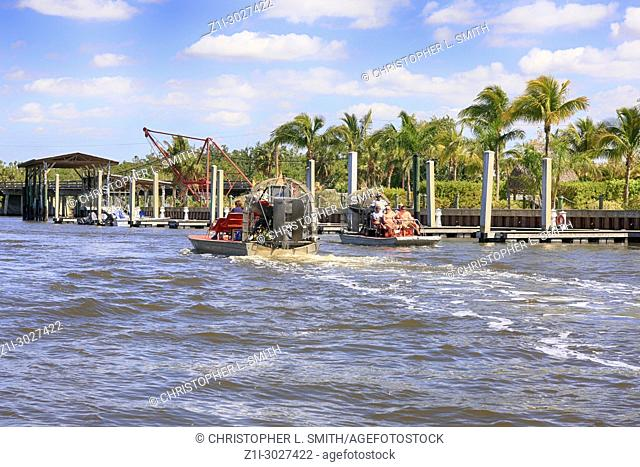 Airboats heading out to the mangrove swamps of the Everglades at Everglades City in Florida USA