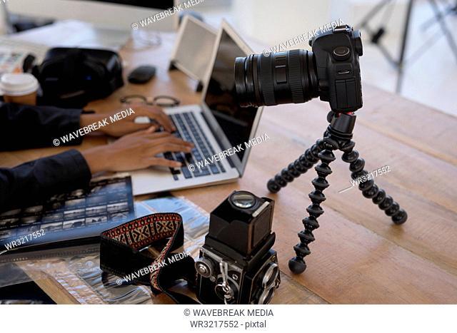 Photographer using laptop on desk