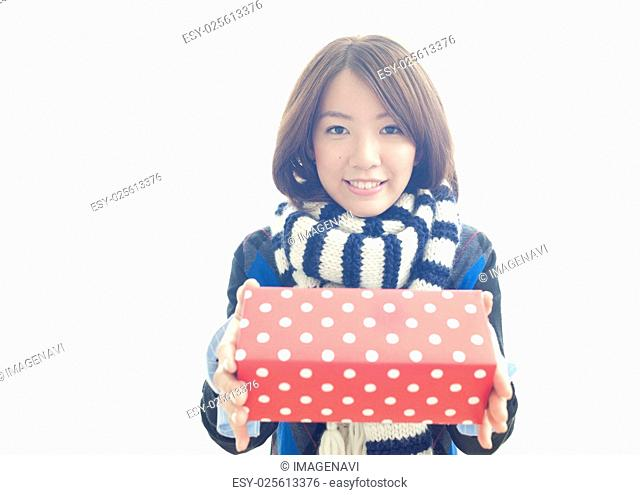 Young woman holding out gift