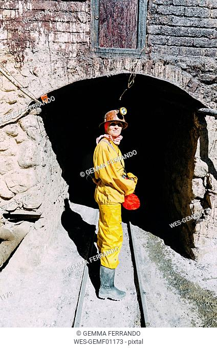 Bolivia, Potosi, tourist wearing protective clothing ready to visit the Cerro Rico silver mine