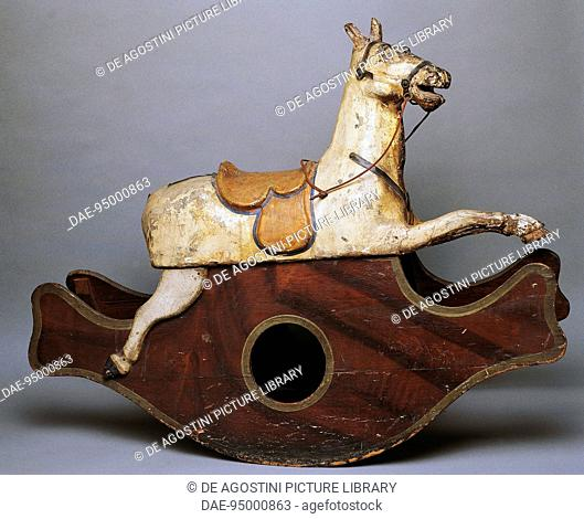 Rocking horse, wooden and painted papier-mache toy. Italy, 20th century.  Milan, Museo Del Giocattolo E Del Bambino (Toys Museum)