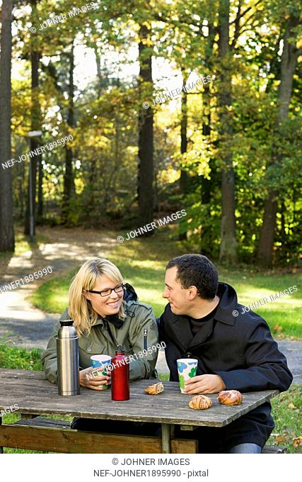 Couple having coffee break outdoor