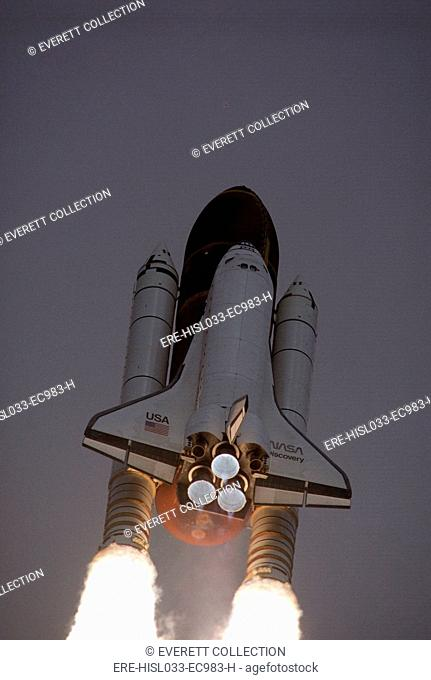 Space Shuttle Discovery launched with Hubble Space Telescope in its cargo bay. April 24, 1990