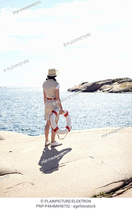 Woman holding a safety buoy