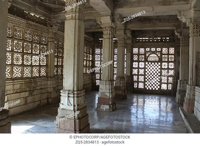 Stone jali work. While the ringed domes, the profusion of pillars and brackets follow the Islamic genre, much of the ornamentation and motifs have Hindu designs