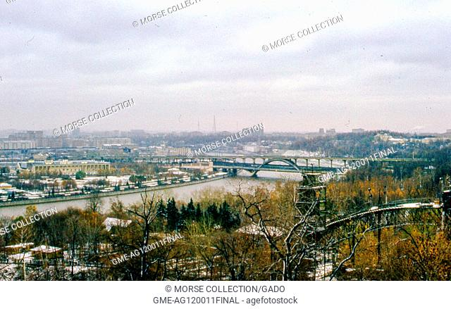 View facing east of the city of Moscow, Soviet Russia, USSR, November, 1973. At center the Luzhnetsky (Luzhnetskaya) Metro Bridge spans the Moscow River