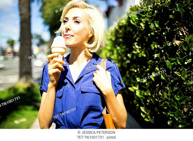 Woman walking with ice-cream