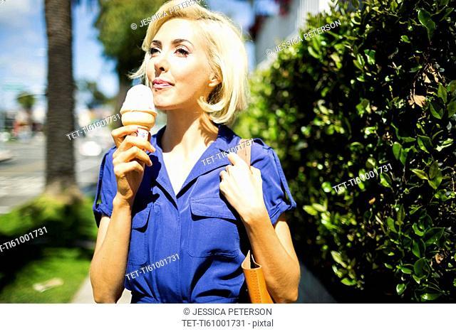 Woman walking with ice-cream
