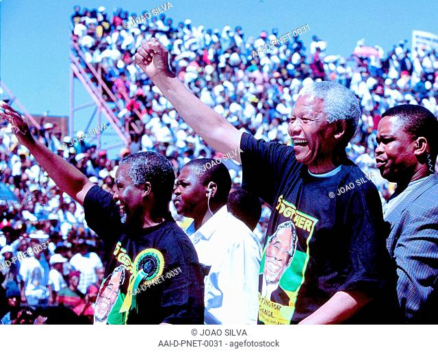MARCH 1999 - President Nelson Mandela and deputy President Thabo Mbeki raise their arms in a salute at the Orlando Stadium in Soweto before the deputy president...