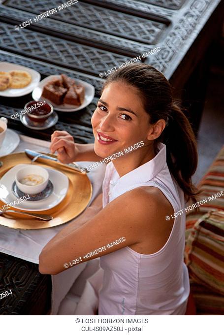 Woman enjoying breakfast, Marrakesh, Morocco