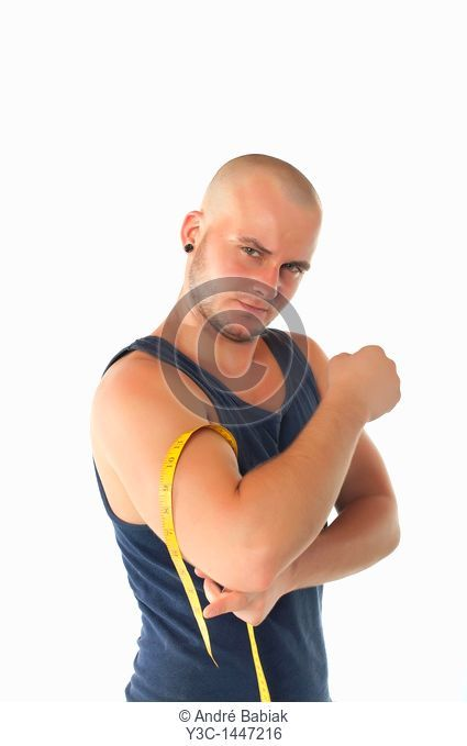 Skinhead hunk measuring muscles