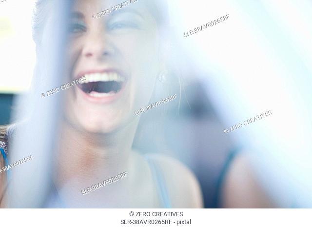 Teenage girl laughing