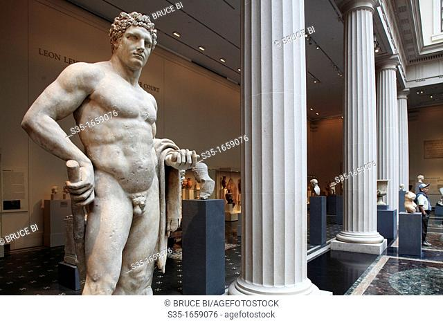 The marble statue of a youthful Hercules from Roman Flavian period display in the exhibition hall of Greek and Roman art in Metropolitan Museum of Art...