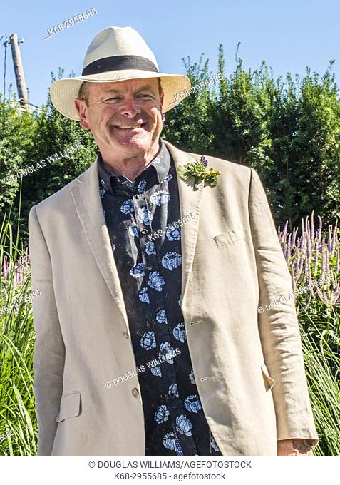 A man, the groom, 65, at his outdoor wedding in West Vancouver, BC, Canada