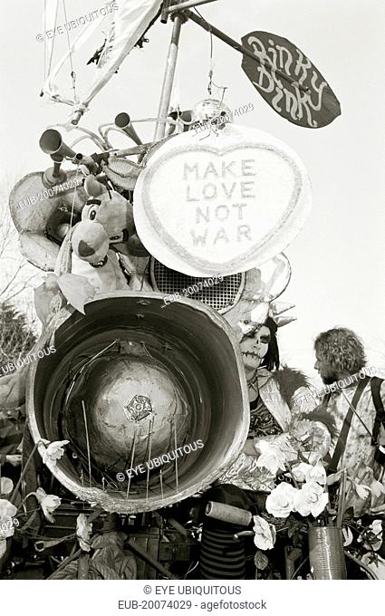 The Rinky Dink and peace protesters during an anti-war rally at RAF Fairford. Make love not war poster