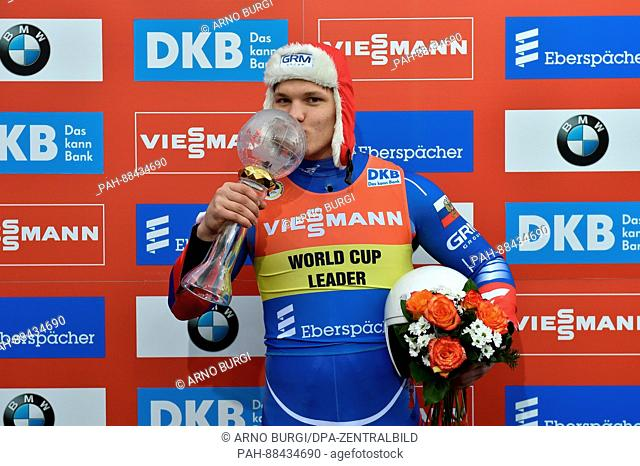 Roman Repilov of Russia celebrates his daily victory and victory at the world cup after the men's singles run at the Luge World Cup in the DKB Eiskanal in...