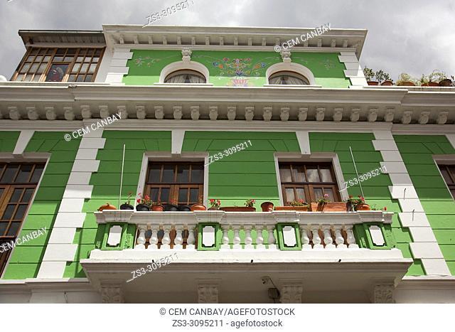 View to the facade of a colonial buildig at the historic center, Quito, Ecuador, South America