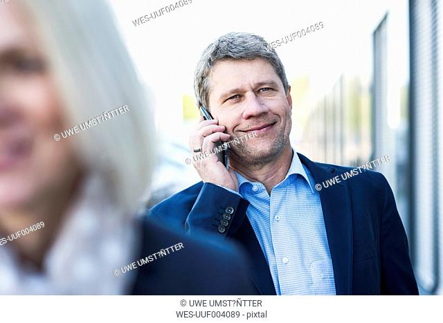 Businessman in street on the phone
