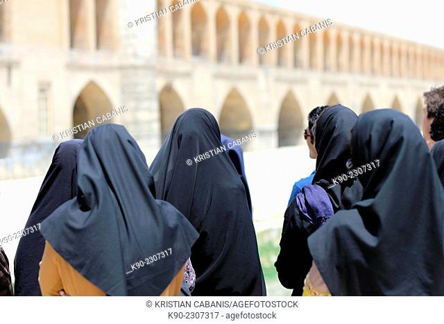 Women in black hijab looking at the Si-o-Seh Bridge, Isfahan, Esfahan, Iran, Asian