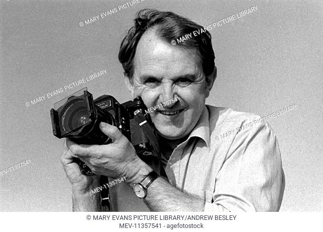 Andrew Besley, photographer, in action with a Pentax 6x7 camera in Cornwall