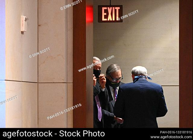 "United States House Judiciary Committee members huddle in a doorway during a markup on H.R. 7120, the """"Justice in Policing Act of 2020, """" in Washington, D"