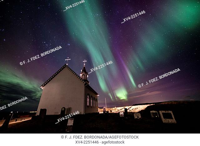 Winter Icelandic landscape with Northern lights background. Iceland