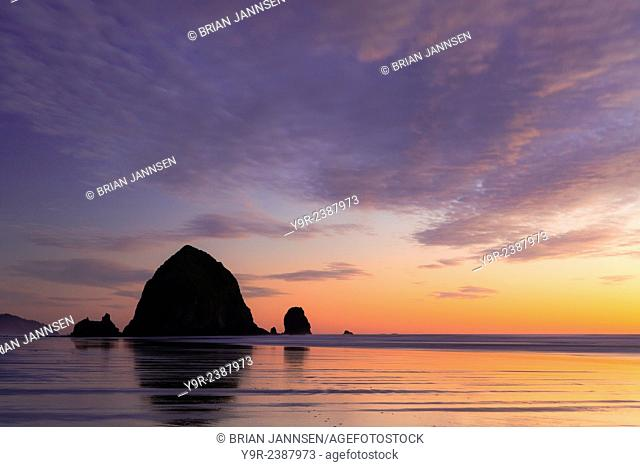 Sunset over Haystack Rock at Cannon Beach, Oregon, USA