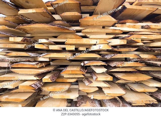 Stacked wood sheets in farm in Santa Maddalena village, Dolomites, Funes valley South Tirol Italy, Europe