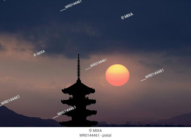 Five story pagoda with evening sun
