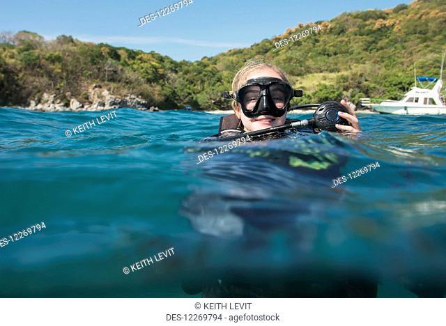 Scuba diver at the surface of the water; Ixtapa-Zihuatanejo, Guerrero, Mexico