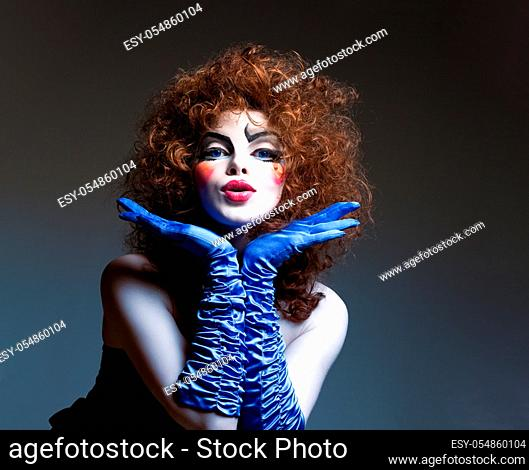 Woman mime with theatrical make-up. Studio shot
