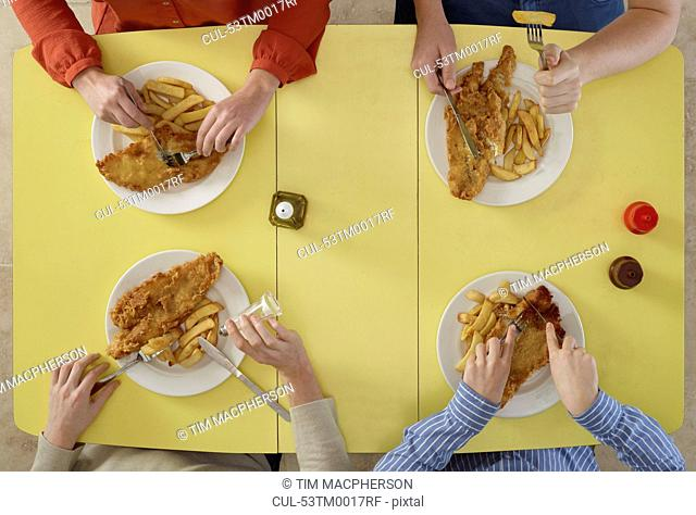 Overhead view of people eating together