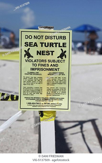 UNITED STATES OF AMERICA, MARCO ISLAND, 22.08.2014, Loggerhead sea turtle nest is protected and roped off with signs on South Marco Beach on Marco Island