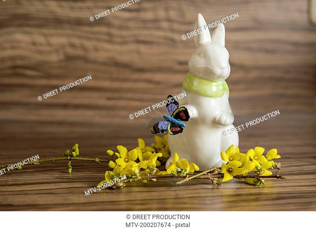 Close-up of Easter bunny with artificial butterfly