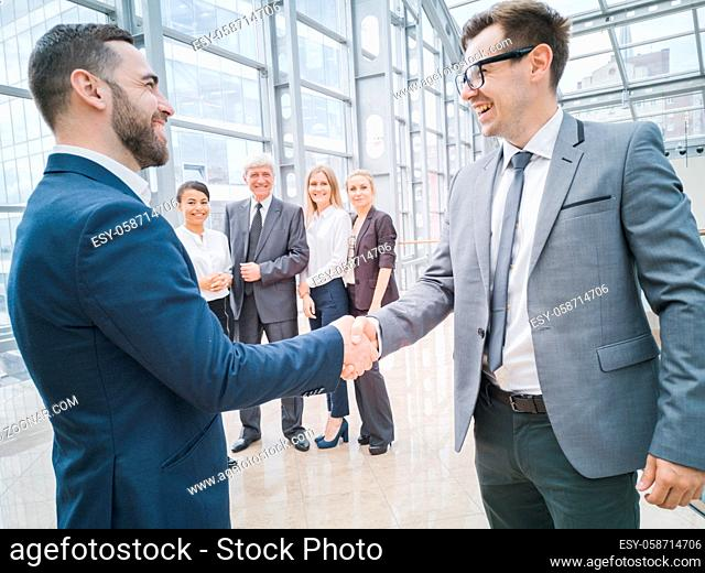 Handshake of business people in the lobby of an office building