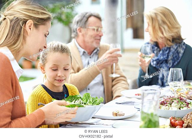 Multi-generation family enjoying lunch on patio