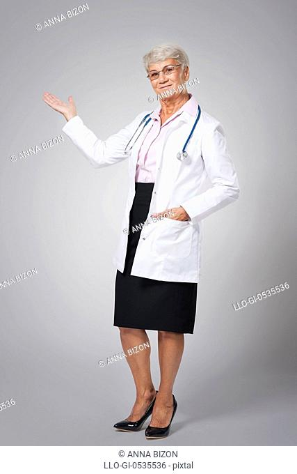 Smiling female doctor pointing at copy space. Debica, Poland