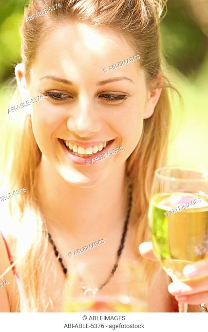Woman holding a glass of white wine