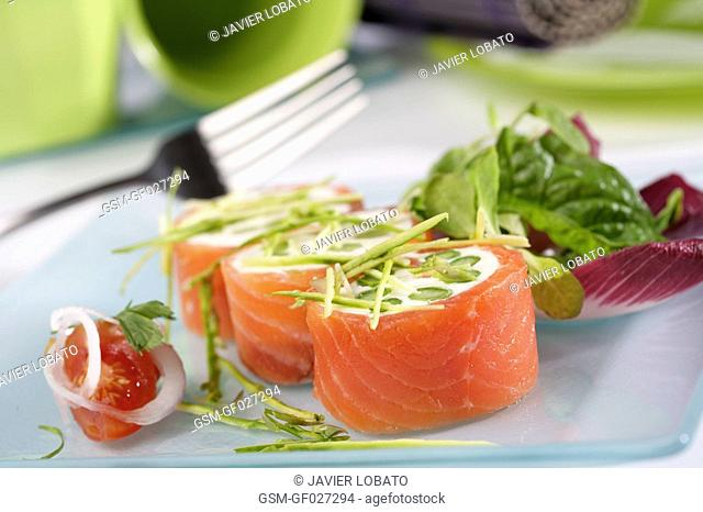 Smoked salmon rolls with cheese cream and asparagus