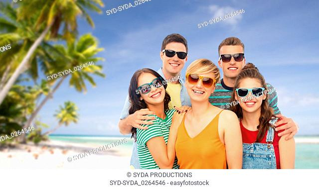 friends in sunglasses over white background
