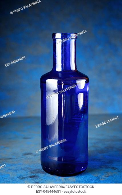 Blue glass bottle on a table