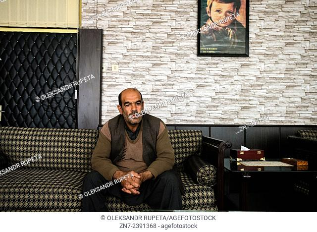 Portrait of cook in health directorate of Afghan Red Crescent Society, Kabul, Afghanistan