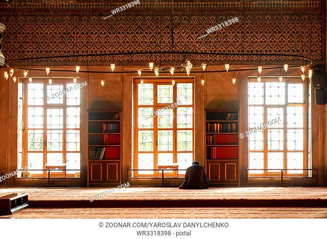 Turkish muslim men praying in suleymaniye mosque in Istanbul, Turkey.Suleymaniye mosque