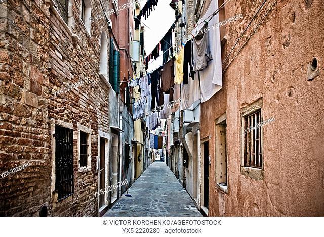 Laundry hanging across a narrow street in Venice, Italy